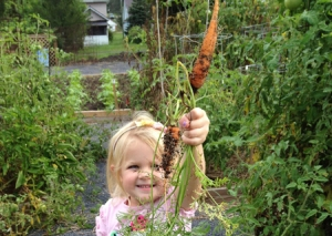 Young gardener with carrot!